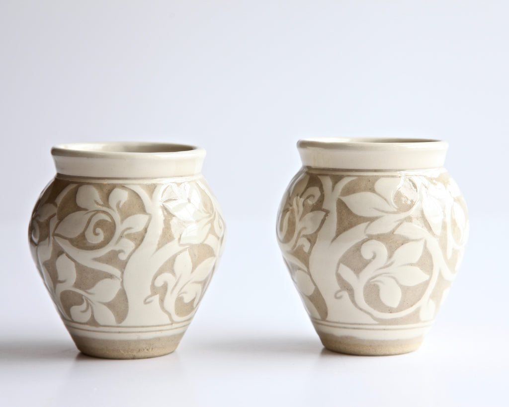 Set of Two Small Cream Carved Vases
