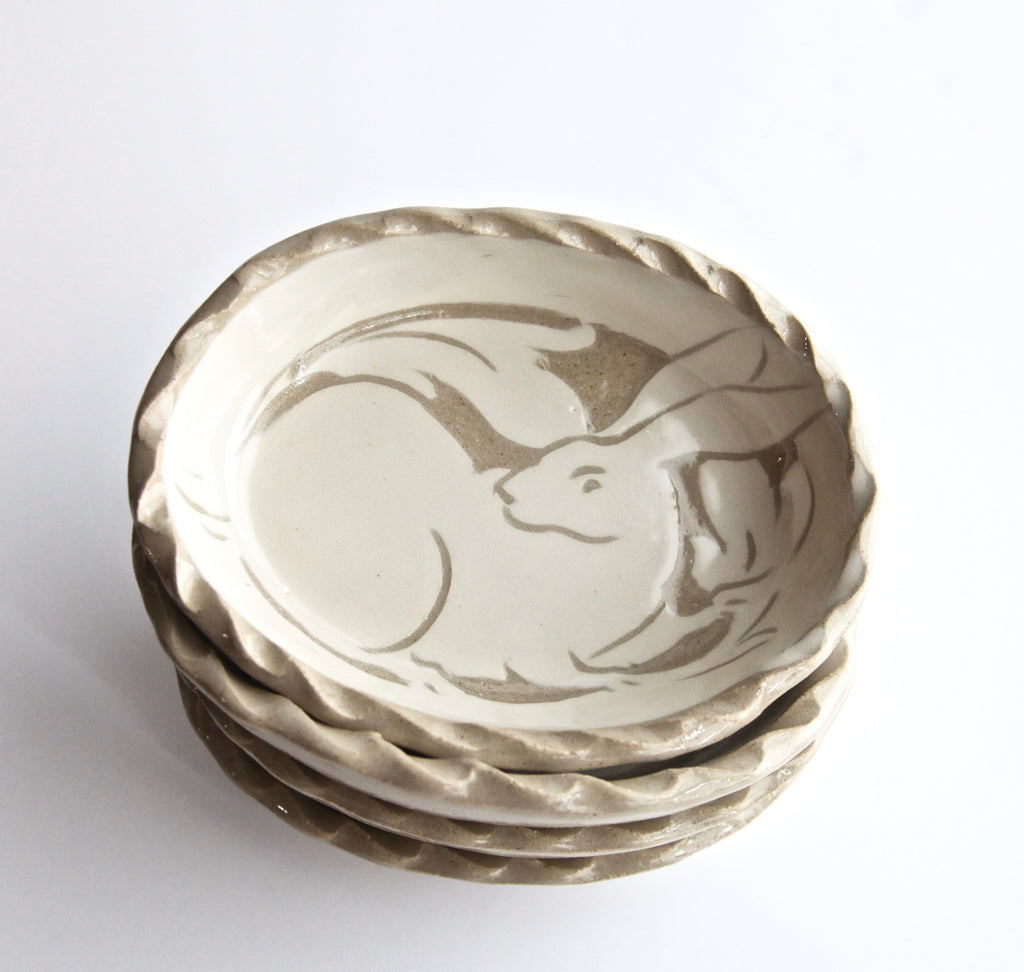 Set of Four Cream Carved Ovals with Rabbits