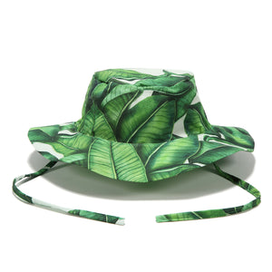 green sun hat for children and babies with banana leaves print
