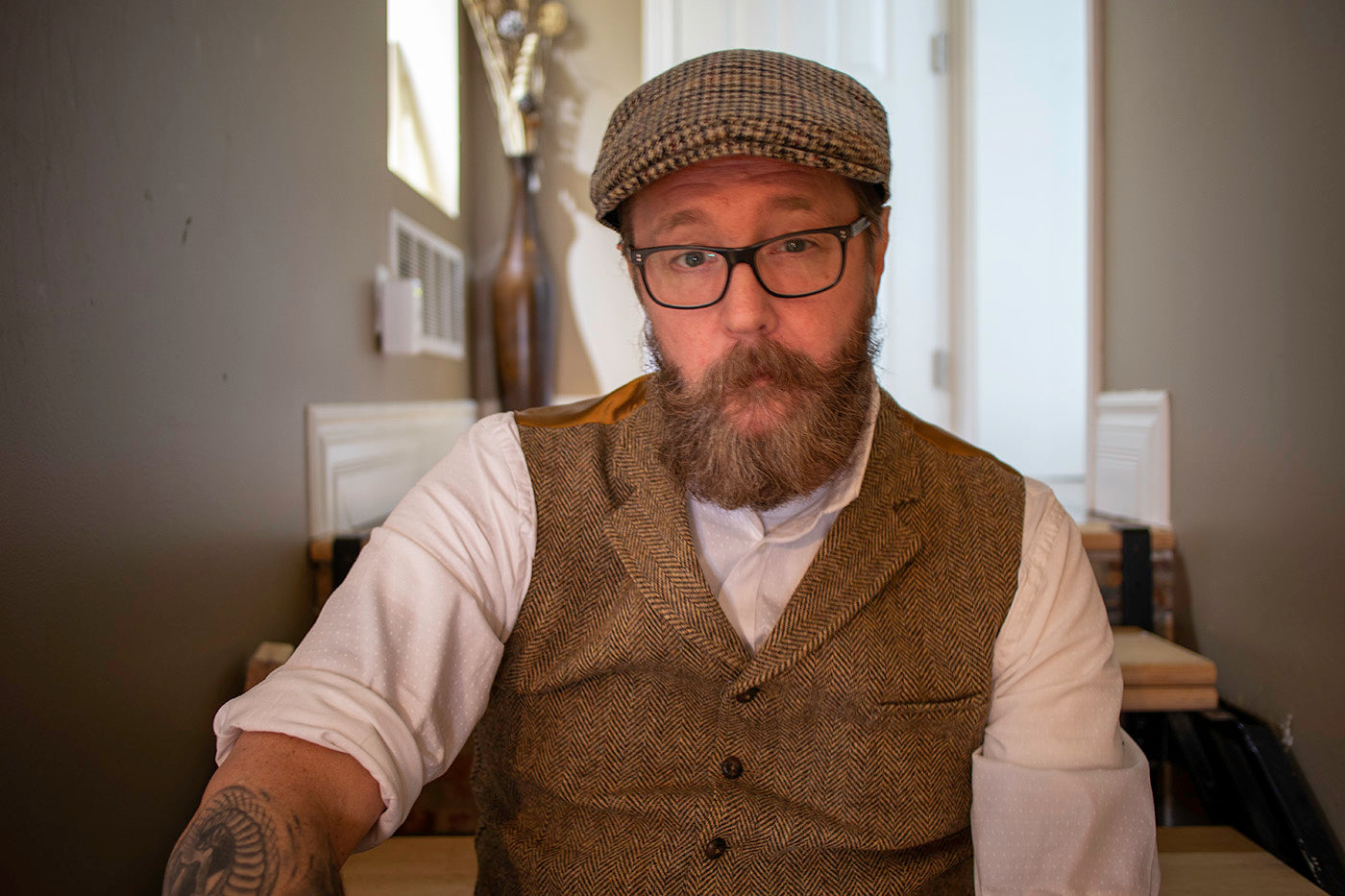 Middle age man names Martin Bliss with large beard wearing a vest and hat - Wicked Beard Company