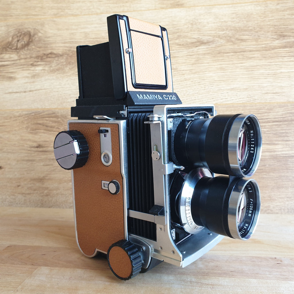 MAMIYA C220 6x6 TLR with 135mm f:4.5 Sekor lens Fully serviced and with Custom Real leather covering.