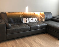 rugby hooded blanket on couch