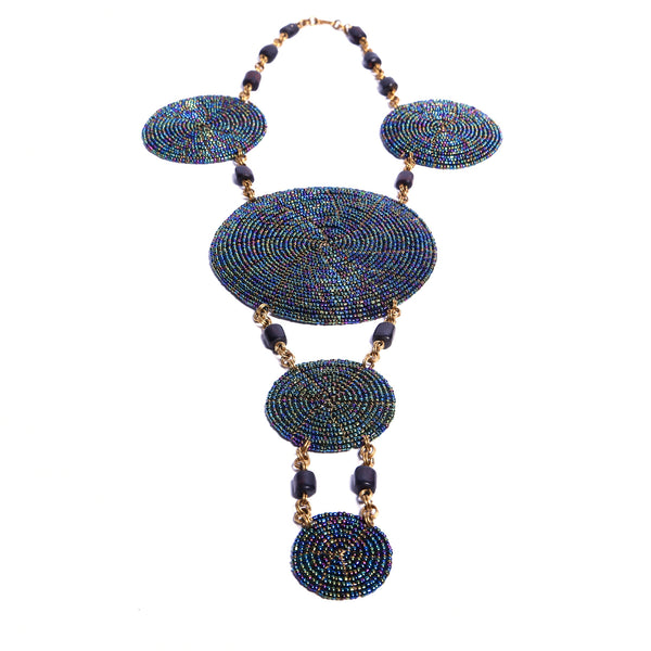 Eye-catching handcrafted statement necklace. Each bead is intricately strung by hand. Truly unique and one-of-a-kind African necklace.