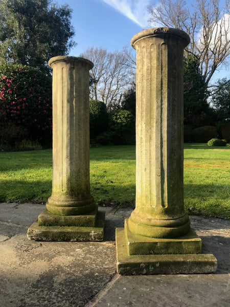 Pair of weathered reconstituted stone plinths. Great indoors as well as outside.