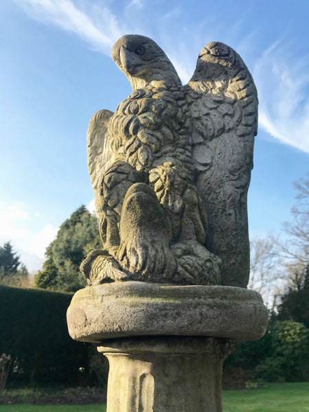 Garden Statue of an Eagle with fish, made from reconstituted stone. Great indoors as well as outside.
