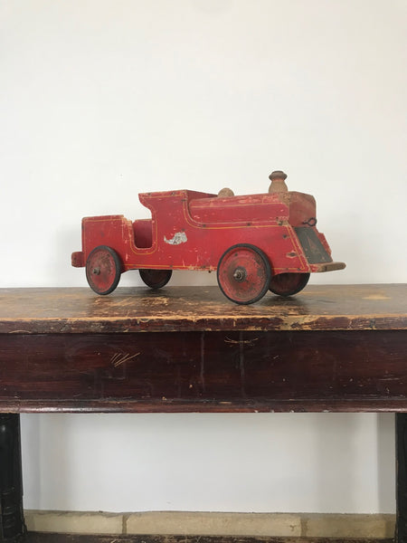 A well loved Red Toy Train.  Made by L.Bros Ltd, London England. Can be left as a decorative item or restored to it's former glory. Structurally sound and all four wheels turn perfectly. Please view all images.  Circa: 1930's