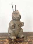 Decorative Antiques - Concrete rabbit. Over time this rabbit has sustained some damage exposing metal rods used in the construction of the ears. Circa: 1940's