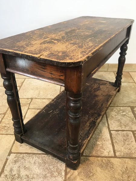 Late C19th drapers table, believed to have come from an old store of Debenhams. Some extra fixings on legs which depict that probably glass panels once would have enclosed the lower section showing off the shops merchandise. Circa:1880's