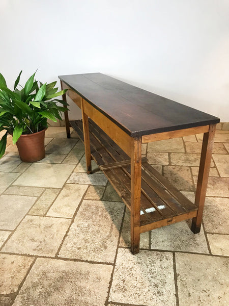 Vintage long draper style table. Originally used in a school science lab. The top is made from teak and the base from oak and pine. Circa: 1955