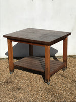Decorative Antiques - A solid vintage table on casters. Slatted pine base and 4.5cm thick teak top. Circa: 1940's