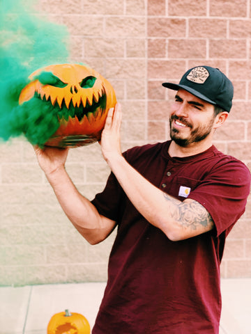 Smoking pumpkin with smoke bomb for Halloween