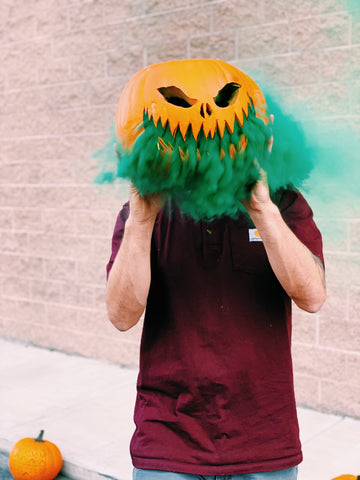 Smoking pumpkin with smoke bomb
