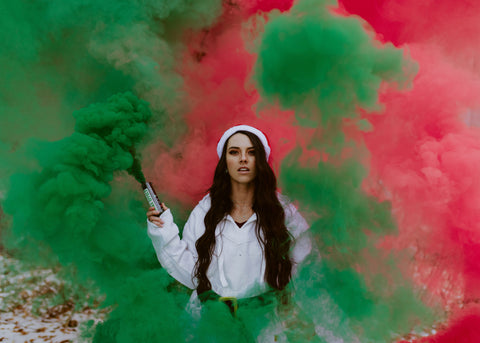 Red and green smoke bomb grenade for holiday photoshoot