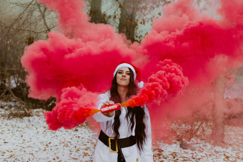 Red powder smoke bomb grenade for Christmas photoshoot