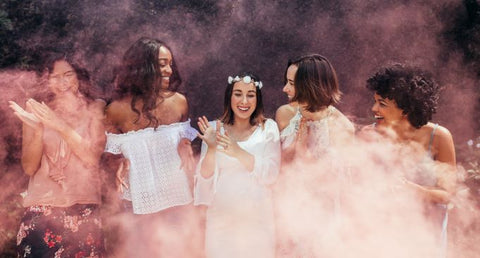 Pink smoke bomb for gender reveal photoshoot