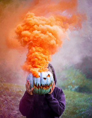 smoke bomb orange smoke grenade in pumpkin