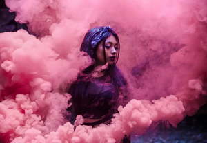 pink smoke bomb for gender reveal photo