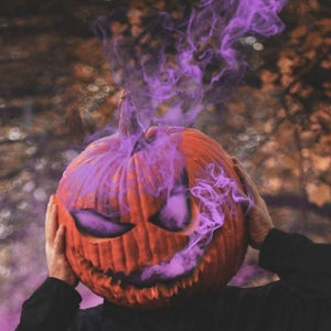 halloween photography purple smoking pumpkin