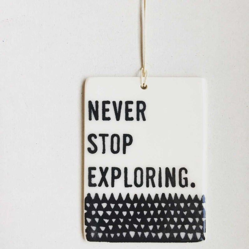 Never Stop Exploring Porcelain Tag