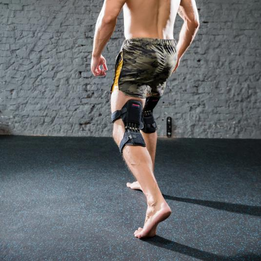 man work out with power knee stabilizer
