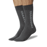Men's Color Names Crew Socks Charcoal On Leg Image One