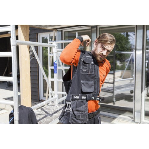 Helly Hansen CHELSEA CONSTRUCTION VEST 76341 Black / Charcoal wearing on site front view