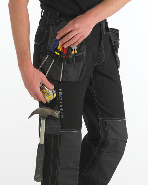 Helly Hansen CHELSEA CONSTRUCTION PANT 76441 Black Charcoal lifestyle image close up view of hanging flap pocket