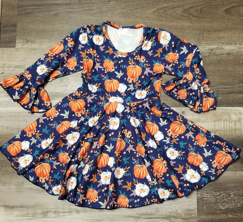 Royal blue bell sleeve twirl dress with orange and white pumpkin print with assorted fall leaves for babies and toddler girls.