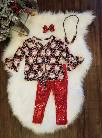 Leopard print button up cardigan top with classic Santa face print throughout.  Included red sequin pants.