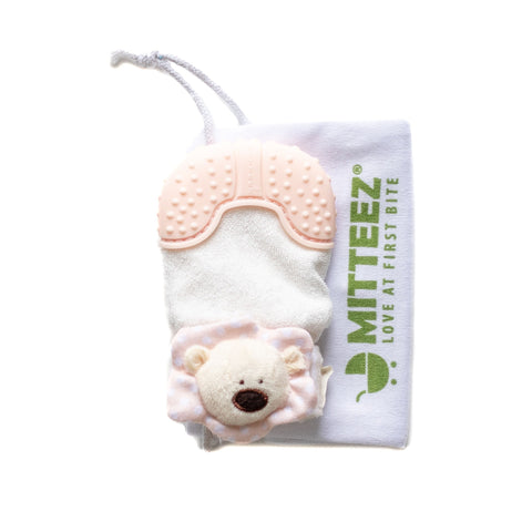 Pink pea bear teething mitten with removable wrist rattle includes bag for travel or for washing.