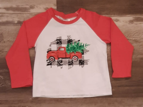 Baseball style shirt with red sleeves and white front.  Red truck with tree imprinted on front, and black and white checked background behind truck.