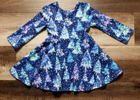 Blue twirl dress with trees throughout in a snowy scene.