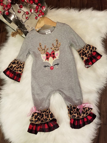 Grey cotton romper with a baby reindeer on front featuring leopard print antlers, a buffalo plaid bow.  The arms and legs feature a layered buffalo plaid and leopard print ruffle.