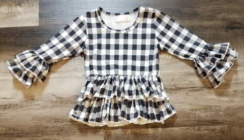 Black and white plaid peplum toddler girls top with double ruffle sleeve and double ruffle at waist.