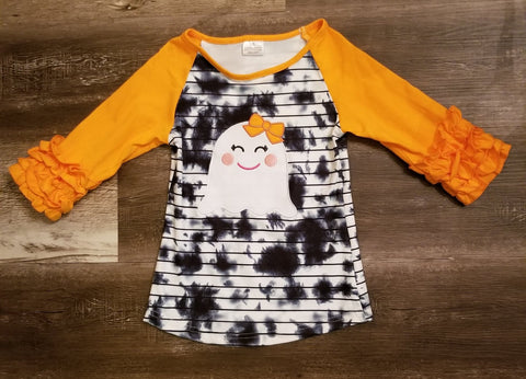 Black and white tie dye raglan with ghost applique and orange icing ruffle sleeves.
