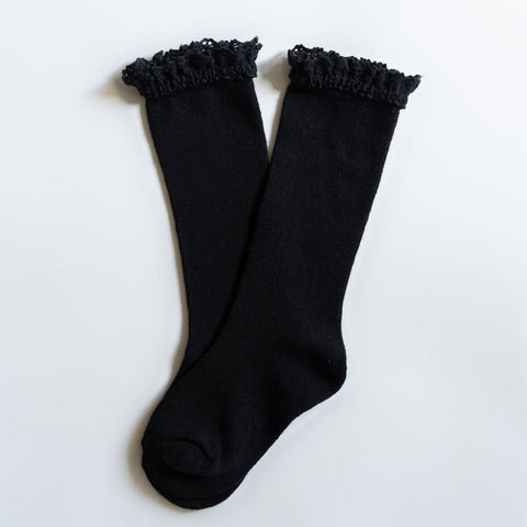 Black knit knee high socks with a lace top for babies, toddlers, and young girls.