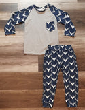 Grey top with sleeves and front pocket in blue fabric with white deer heads.  Joggers in blue fabric with white deer heads.