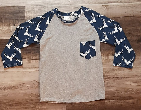 Grey cotton top with sleeves and pocket in blue with white deer heads.