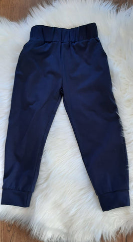 Navy Blue Jogger pants with elastic waist and pockets.