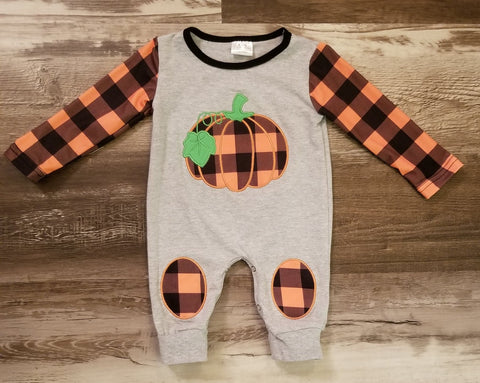 Grey baby boy romper with orange and black plaid print sleeves, pumpkin applique on front, and knee patches.