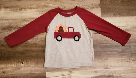Grey boys baseball top with maroon sleeves and applique on the front of a truck with a turkey in the back.