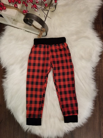 Unisex toddler buffalo plaid joggers with pockets and an elastic waistband.  Black trim on waist and ankle cuffs.
