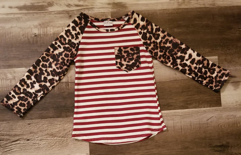 Burgundy striped top with buttery soft leopard print long sleeves and a leopard print pocket on front.