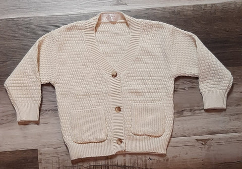 Cream knit V-neck button up cardigan sweater.