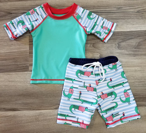 Boys crocodile swim trunk and rash guard shirt.