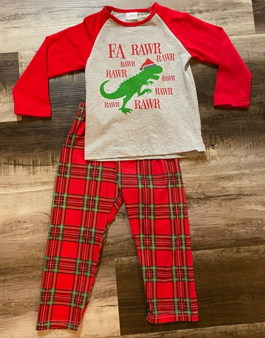 Boys two piece pajama set with a Santa Dinosaur, and Fa Rawr Rawr print on front of grey top with red sleeves. Bottoms are red and green plaid print.
