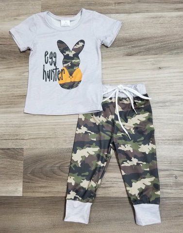 Light grey short sleeve top with egg hunter and a camo print bunny wearing a hunting vest.  Set included camo print jogger pants.