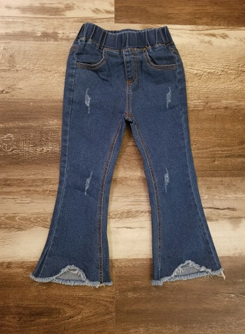 Lightly distressed elastic waist denim jeans in a medium wash with a fringe flare hemline and pockets in front and back.