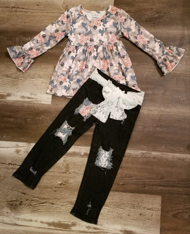 Bell sleeve top with floral camo print and dark wash denim with lace and camo floral patches.