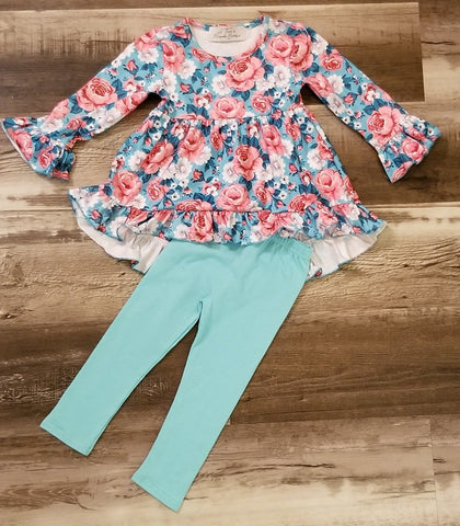 Beautiful floral pattern high-low top with bell sleeves, and mint straight leg leggings.